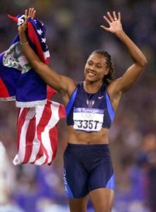 'Admitting' her drug use ... Marion Jones of the United States celebrates after winning the gold medal in the 100m at Olympic Stadium in Sydney.
